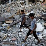 Palestinian boys search the debris of destroyed houses in the town of Beit Lahiya (Barcroft India)