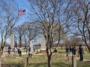 Participants walk through the cemetery and memorials at the former site of Rohwer Internment Camp.