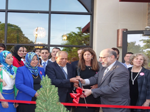 Falah Tabahi,restaurant's founder and head, prepares to cut the ribbon on opening day.