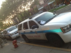 (These police cars are illegally parked. That's a second reason to decorate their windshields.)