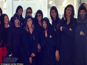 Kendall Jenner (far right) Selena Gomez (middle with hands together) and friends cover up in hijabs for a visit to Sheikh Zayed Grand Mosque in Abu Dhabi.