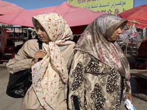 Uighur Muslim women in Xinjiang [AP]