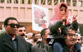 Muhammad Ali, left, participates in a Palestinian protest march in Chicago on January 29, 1988. (AP Photo / Fred Jewell)