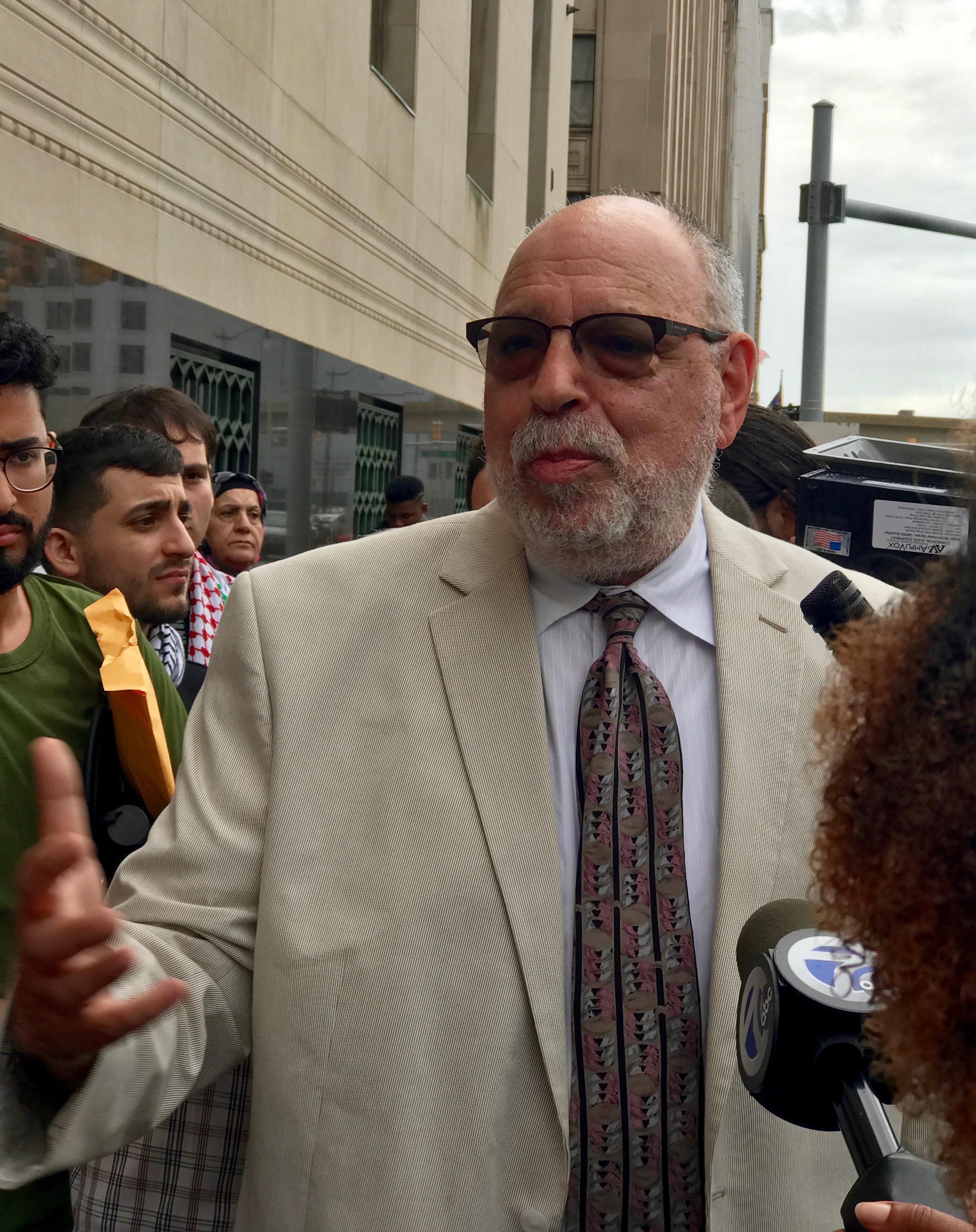 Michael Deutsch speaking to reporters. (Photo by Bill Chambers)