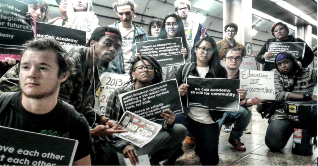 "Members of #NoCopAcademy raise awareness through initiative known as ""train takeover"""