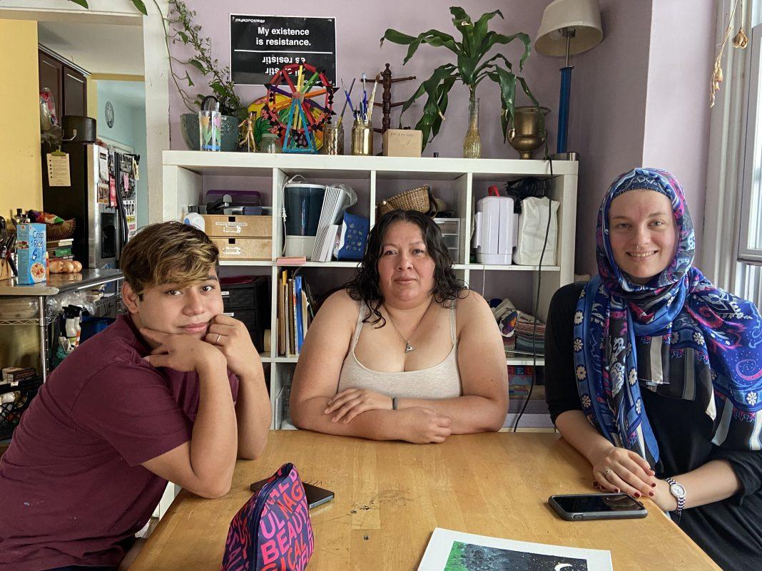 Violetta, Martha, and Lyn Rye sitting in Casa Al-Fatiha